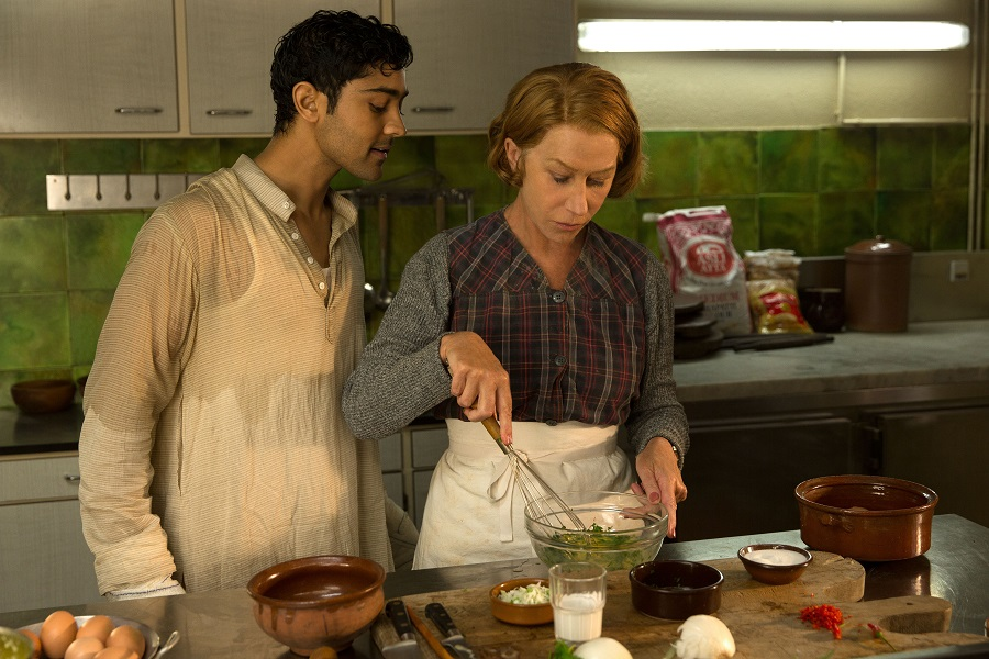 "HFJ-0068r When Hassan Kadam (Manish Dayal) and his family move from India to a village in the South of France, they open a restaurant and encounter Madame Mallory, (Academy Award®-winner Helen Mirren) the chef proprietress of a classical Michelin-starred French restaurant across the street. Cultures collide, but they eventually find common ground through their love of cooking, in DreamWorks Pictures' charming film, ""The Hundred-Foot Journey."" Based on the novel ""The Hundred-Foot Journey"" by Richard C. Morais, the film is directed by Lasse Hallström. The producers are Steven Spielberg, Oprah Winfrey and Juliet Blake. Photo: François Duhamel ©2014 DreamWorks II Distribution Co., LLC. All Rights Reserved."