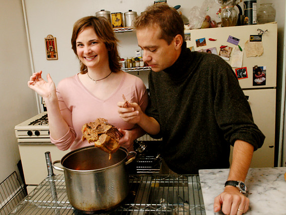 """Eric and Julie Powell pose for a photograph in their home on October 18, 2005. Julie's new book """"Julie and Julia"""" was recently released. Eric tasted the food in her book. Original Filename: 10_18julieandjulia05.jpg"""